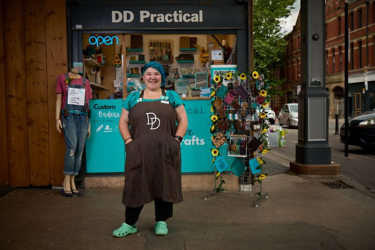 Picture of Dani outside the DD Practical Shop